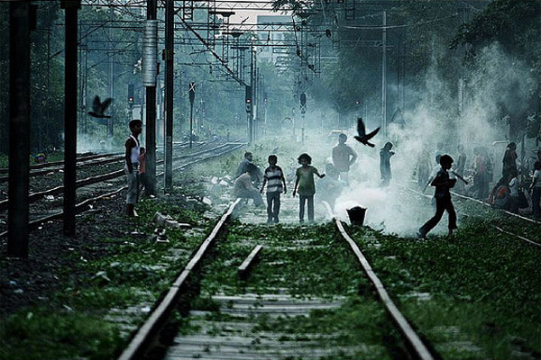 Children Playing on Railway Track